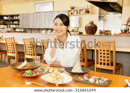 Japanese woman drinking at the Japanese tavern - stock photo