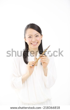 japanese woman have a brush isolated on white background