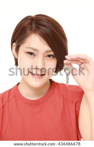Japanese woman in a red shirts with home key