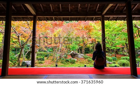 Japanese woman in Enkoji temple enjoys Autumn colorful Japanese garden in Kyoto, Japan - stock photo