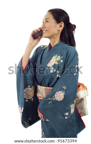 Japanese woman in kimono talking on the phone isolated over white background - stock photo