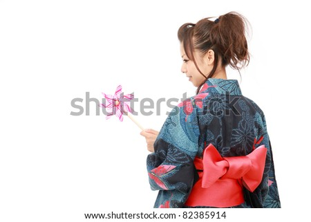 Japanese woman in traditional clothes of Kimono with pinwheel