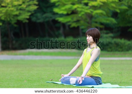 Japanese woman outside doing meditation