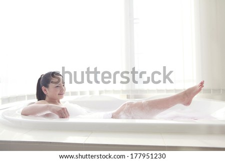 Woman bathing stock photos images pictures shutterstock - Relaxing japanese bathroom design for ultimate relaxation bath ...