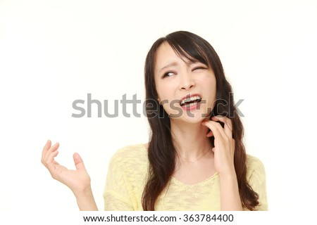 Japanese woman scratching her neck