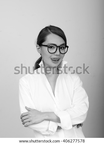 Japanese woman showing tongue - stock photo