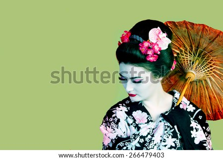 Japanese woman shows kimono with an umbrella,An Image of Apprentice Geisha