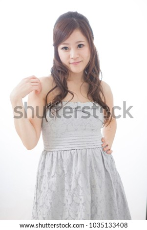 Japanese woman standing in front of a white wall