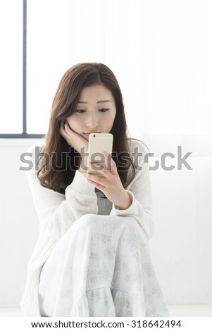 Japanese woman touching the smartphone
