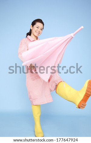 Japanese woman walking wearing rain gear