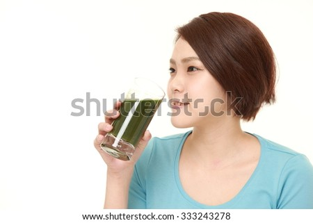 Japanese woman with green vegetable juice