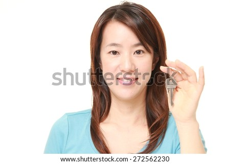 Japanese woman with home key