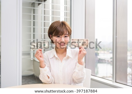 japanese woman with japanese yen and american dollar - stock photo