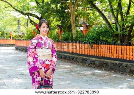Japanese woman with kimono in traditional temple - stock photo