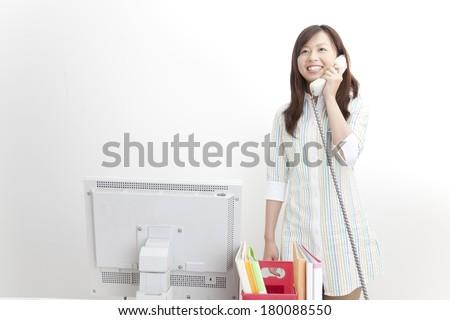 Japanese women answers the phone - stock photo