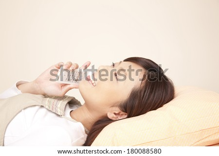 Japanese women who are calling while lying down - stock photo