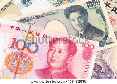 Japanese Yen and Chinese Yuan banknote money