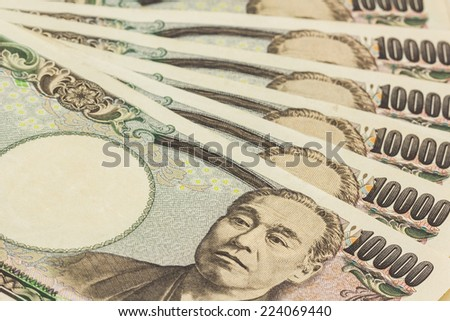 Japanese Yen banknotes on white background.