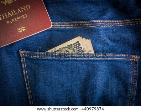 Japanese Yen currency banknote in jeans pocket with Thailand passport book