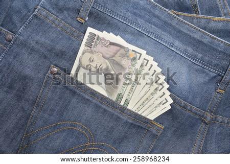 japanese yen in jeans pocket - 10,000 yen - stock photo