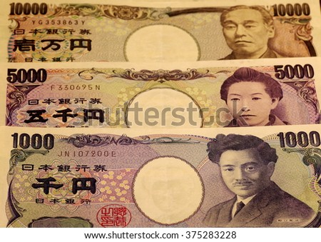 Japanese Yen notes of 1000, 5000, and 10000 - stock photo