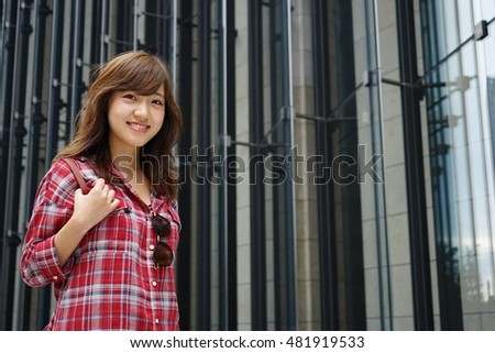 Japanese young woman walking on urban area