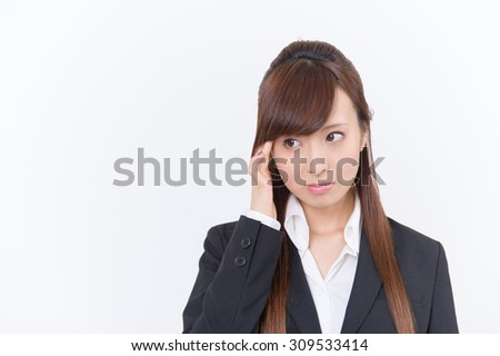 Japanese young woman with a headache holding head, isolated on white background - stock photo