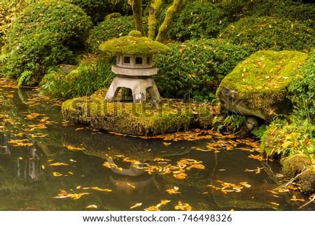 Genial Japanese Zen Garden And Water Pond With Autumn Fallen Leaves