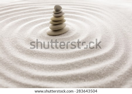 Japanese zen garden meditation for concentration and relaxation sand for harmony and balance in pure simplicity - macro lens shot - stock photo