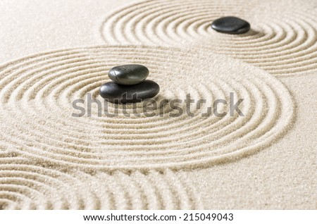Japanese zen garden with black pebbles