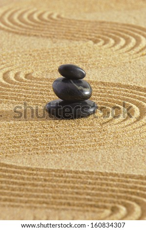 Japanese zen garden with stack of stones