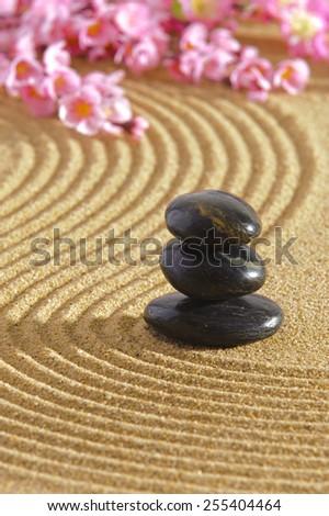 Japanese ZEN garden with stacked stones in sand - stock photo