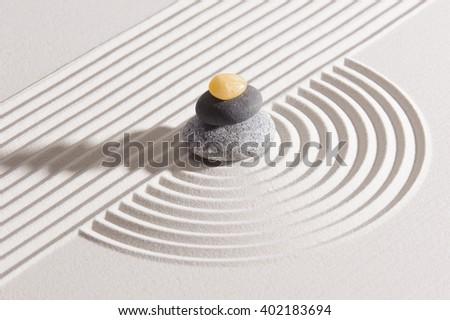Japanese ZEN garden with stone in raked sand - stock photo