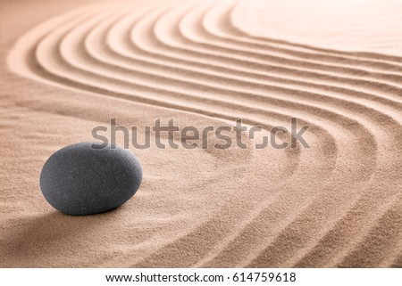 Japanese zen stone and sand garden for Buddhism meditation or a spa wellness background with copy space.