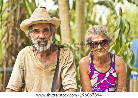 JAPERI, BRAZIL - NOVEMBER 22, 2013: Elderly couple on a rural community rests while waiting the governmental ceremony for the issuance of land possession. November 22, 2013 in Japeri, Brazil