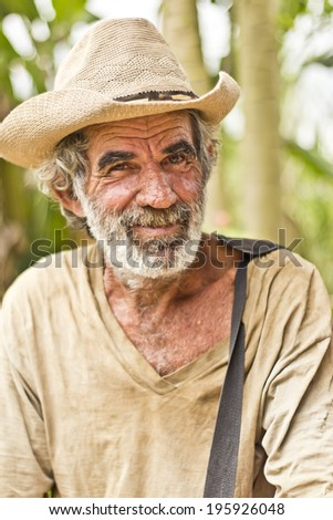 JAPERI, BRAZIL - NOVEMBER 22, 2013: Elderly man on a rural community smiles while waiting the governmental ceremony for the issuance of land possession. November 22, 2013 in Japeri, Brazil