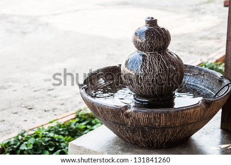 Jar fountain decorated home  garden - stock photo