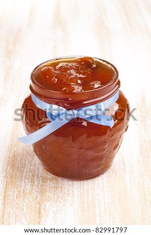 Jar full of apricot jam - stock photo