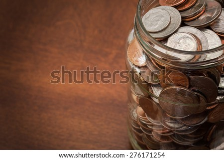 Jar full of coins background - stock photo