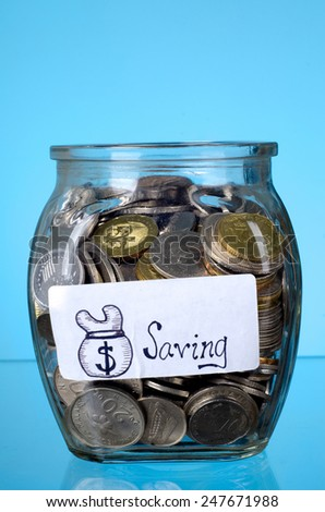 Jar full of coins for saving - stock photo