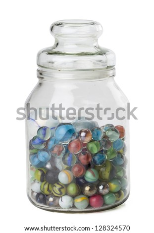 Jar of assorted marbles isolated in a white background - stock photo