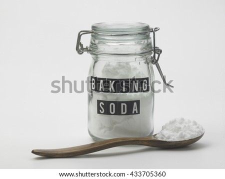 jar of baking soda and spoon on the white background