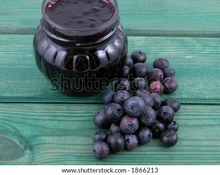 jar of blueberry jam and some fresh berries - stock photo