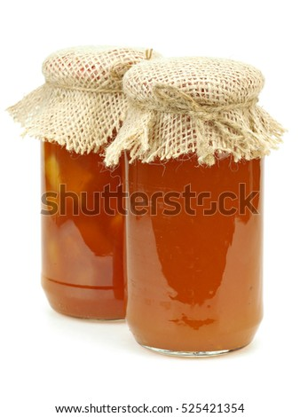 Jar of cherry plum jam on a white background