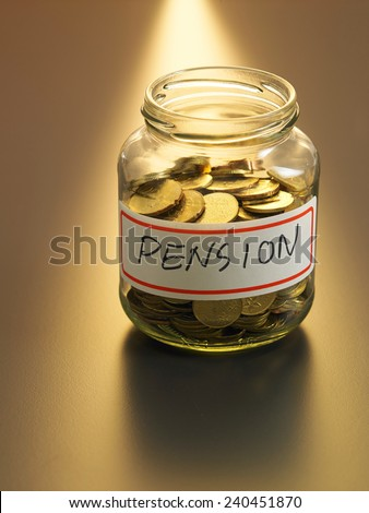 jar of coin with pension sticker - stock photo