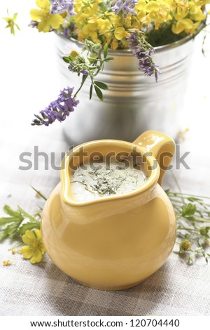 Jar of dill sauce on the table