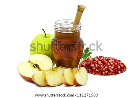 Jar of honey and festive fruits isolated on white background