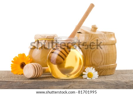 jar of honey and stick isolated on white background - stock photo
