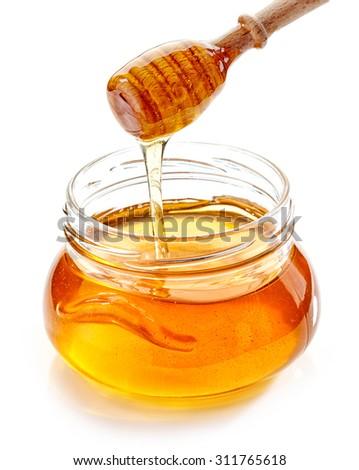 jar of honey isolated on white background - stock photo