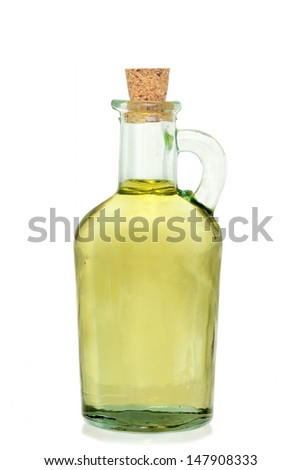 jar of olive oil on white